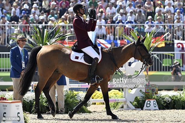 Qatar's Sheikh Ali Al Thani riding First Devision reacts during the jumping competition at the Olympic Equestrian Centre during the Rio 2016 Olympic...