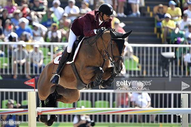 Qatar's Sheikh Ali Al Thani riding First Devision takes part in the jumping competition at the Olympic Equestrian Centre during the Rio 2016 Olympic...