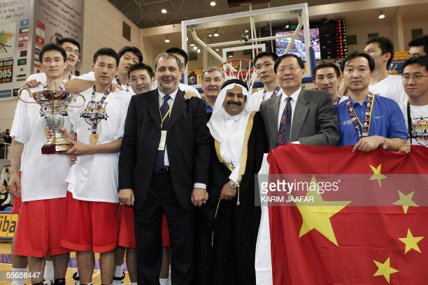 Qatar's Sheikh Saud bin Ali al-Thani , FIBA's Asian president, poses with the Chinese national basketball team after they beat Lebanon in the finals...