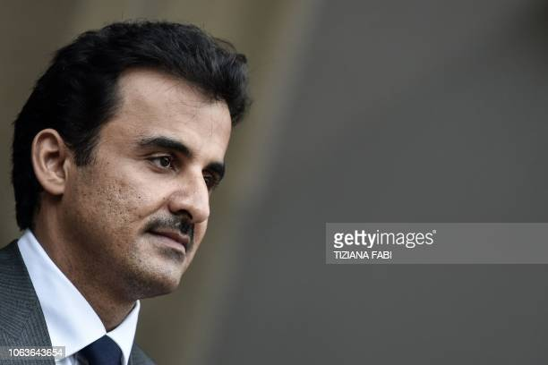 Qatar's Sheikh Tamim bin Hamad al-Thani stands at attention upon his arrival for a meeting with Italys prime minister at Villa Phamphili in Rome on...