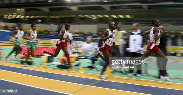 Qatar's Sultan Zaman leads the 3000m race during the Third Asian Indoor Athletics Championships at the Aspire Acedemy of sports in Doha on February...