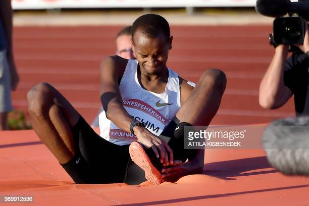 Qatar's winner Mutaz Essa Barshim touches his injured ankle after his world record attempt on 236 meters during the Gyulai Istvan Memorial Hungarian...
