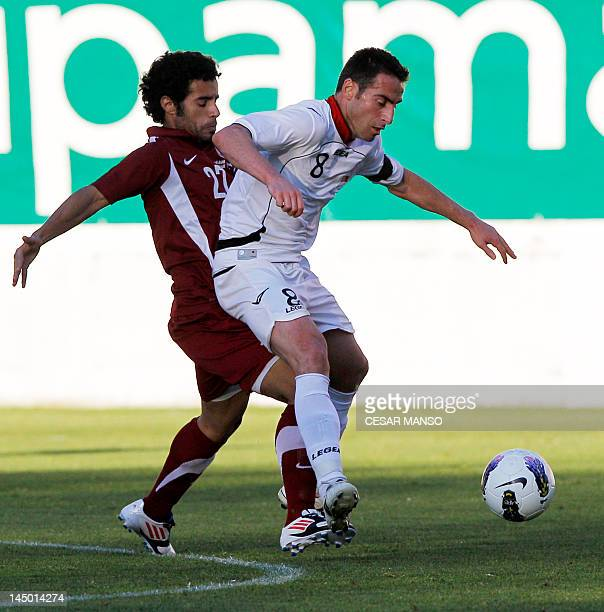 Qatar's Younes Ali vies with Albania's Mesaad Ali during a friendly football match Albania vs. Qatar at Vallecas stadium in Madrid on May 22, 2012....