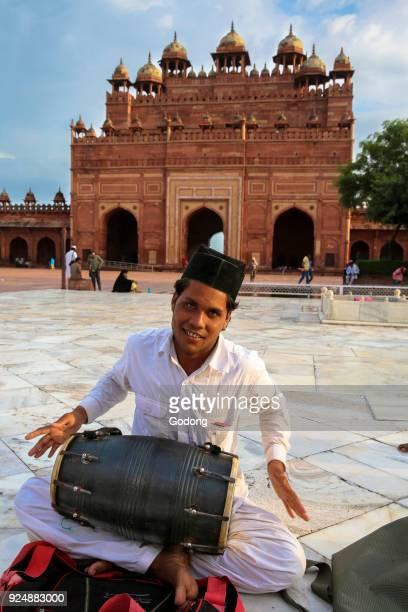 Qawali musician performing in the courtyard of Fatehpur Sikri Jama Masjid Fatehpur Sikri India