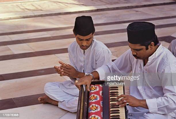 Qawwals at shrine of Sufi saint Nizamuddin Auliya Delhi India