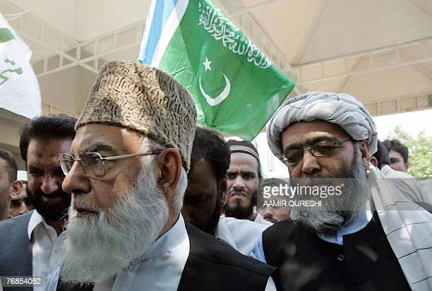 Qazi Hussain Ahmed the chief of Pakistan's Islamist fundamentalist party JamaateIslami and Hafiz Hussain Ahmed leave the Supreme Court in Islamabad...