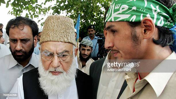 Qazi Hussain Ahmed the chief of Pakistan's Islamist fundamentalist party JamaateIslami is surrounded by supporters as he leaves the Supreme Court in...