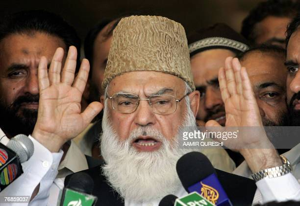 Qazi Hussain Ahmed the chief of Pakistan's Islamist fundamentalist party JamaateIslami talks to media representatives outside the Supreme Court in...