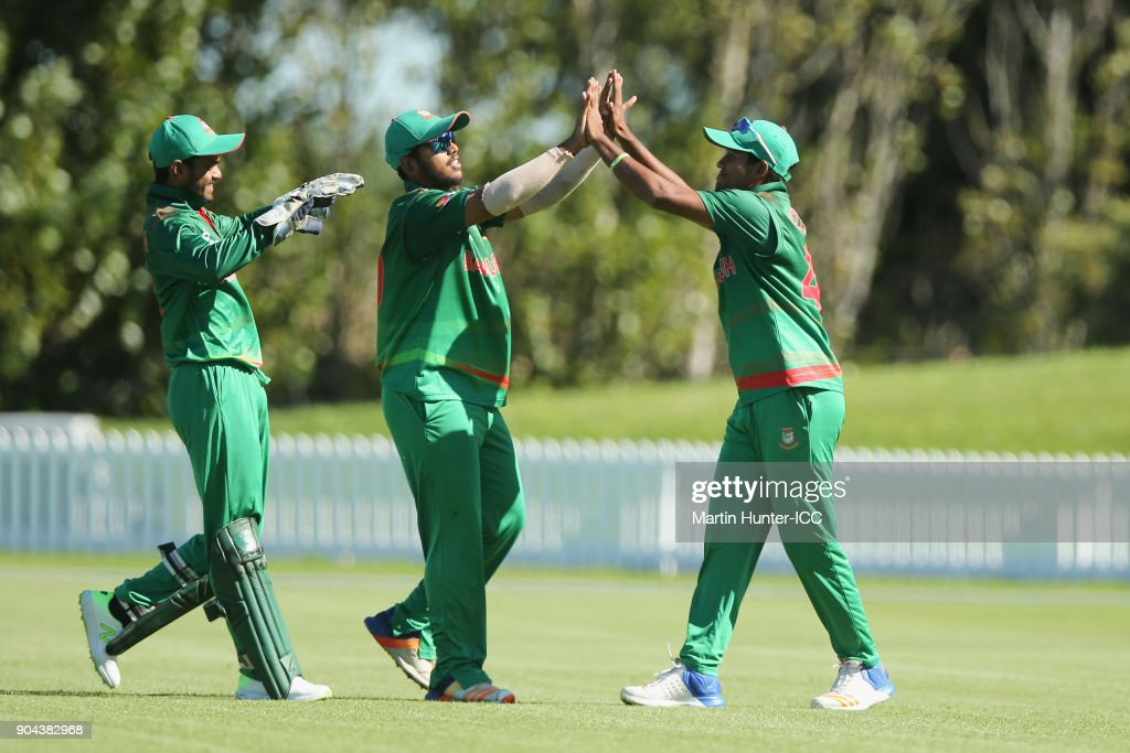 Qazi Onik (R) of Bangladesh celbrates with team mates after holding a catch during the ICC U19 Cricket World Cup match between Bangladesh and Namibia at Bert Sutcliffe Oval on January 13, 2018 in Christchurch, New Zealand.