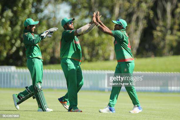 Qazi Onik of Bangladesh celbrates with team mates after holding a catch during the ICC U19 Cricket World Cup match between Bangladesh and Namibia at...