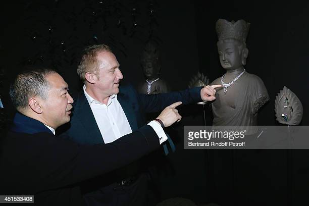 Qeelin jeweler Dennis Chan and CEO Kering Francois Henri Pinault attend the 'Qeelin' high Jewellery Exhibition opening Cocktail 'Mogoaku in Paris' at...