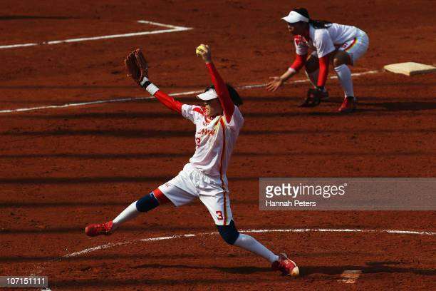 Qi Li of China pitches in the semifinal match against Chinese Taipei at Tianhe Softball Field during day fourteen of the 16th Asian Games Guangzhou...