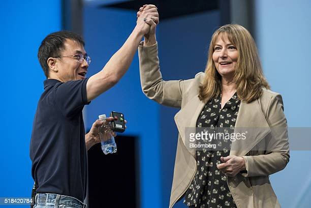 Qi Lu executive vice president of the applications and services group at Microsoft Corp left and Gerri MartinFlickinger chief technology officer at...