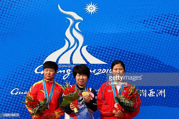 Qi Sun of China Yunmi Gim of South Korea and Wen Jun Guo of North Korea pose with the medals won in the Women's 10m Air Pistol final at the Aoti...