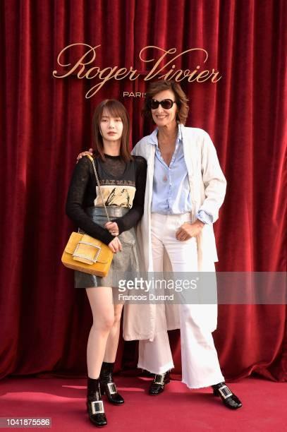 Qi Wei and Ines de la Fressange attend the Roger Vivier Presentation Spring/Summer 2019 during Paris Fashion Week on September 27 2018 in Paris France