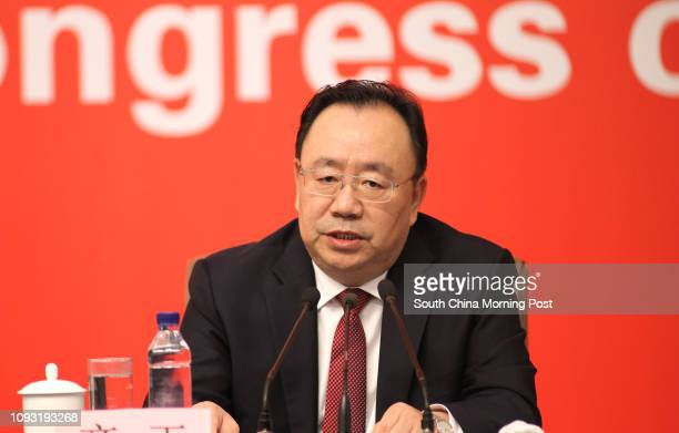 Qi Yu, Minister of the Organization Department of the Central Committee of the CPC, speaks at a presser conference at the media center of the 19th...