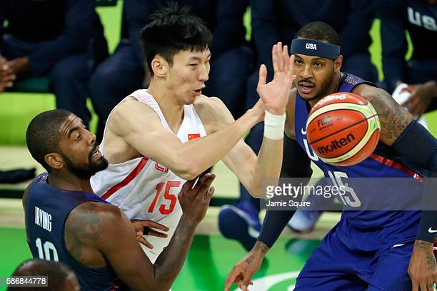 Qi Zhou of China goes for the loose ball against Kyrie Irving and Carmelo Anthony of United States on Day 1 of the Rio 2016 Olympic Games at Carioca...