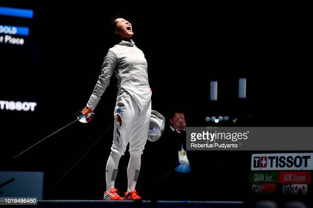 Qian Jiarui of China reacts after beating Kim Jiyeon of Korea during Women's Sabre Individual Semifinal match on day one of the Asian Games on August...