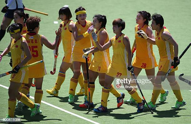 Qian Yu of China celebrates her team's second goal with her teammates during the quarter final match between China and Korea on day 6 of the Hockey...