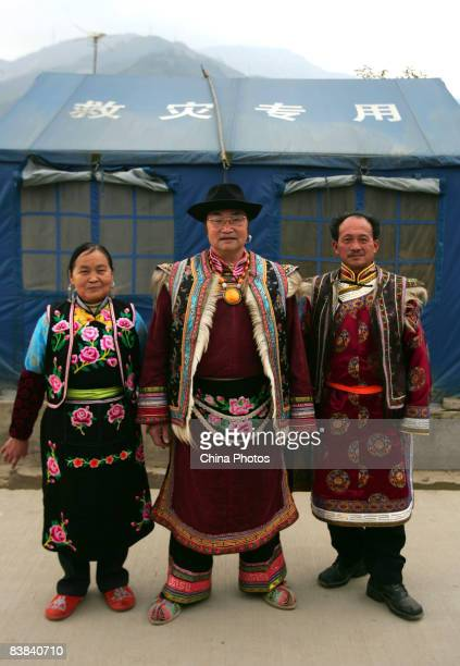 Qiang tourism promotor Mu Guangyuan a 68yearold Qiang ethnic man his wife 67yearold Zhou Tiancui and 56yearold Guozhuang Dancing teacher Wang...