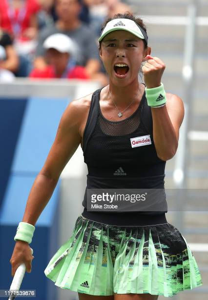 Qiang Wang of China celebrates a point during her Women's Singles fourth round match against Ashleigh Barty of Australia on day seven of the 2019 US...