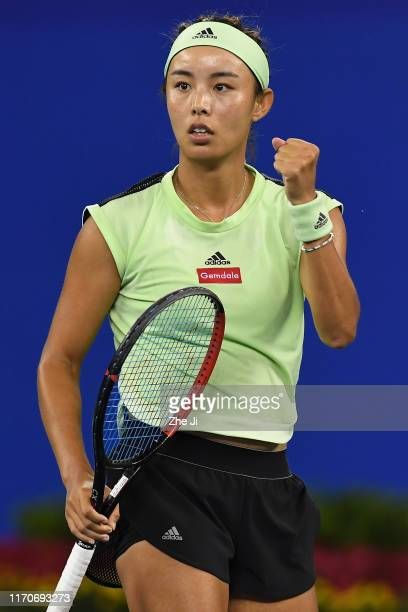 Qiang Wang of China celebrates a point during the match against Marie Bouzkova of the Czech Republic on Day 3 of 2019 Dongfeng Motor Wuhan Open at...