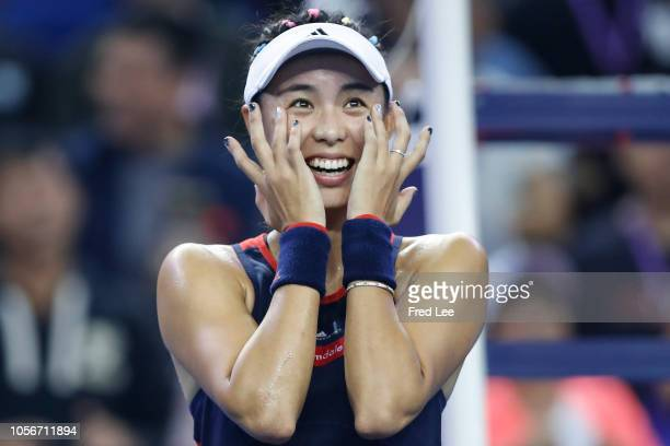 Qiang Wang of China celebrates after defeating Garbine Muguruza of Spain during their women's singles Semifinal match on day 5 of the 2018 WTA Elite...