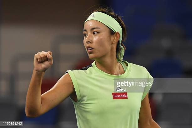 Qiang Wang of China celebrates after defeating Marie Bouzkova of the Czech Republic on Day 3 of 2019 Dongfeng Motor Wuhan Open at Optics Valley...