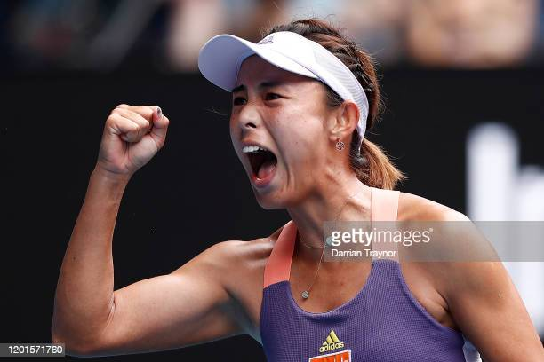 Qiang Wang of China celebrates after winning a point during her Women's Singles third round match against Serena Williams of the United States on day...