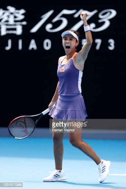 Qiang Wang of China celebrates after winning match point during her Women's Singles third round match against Serena Williams of the United States on...