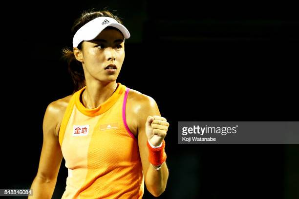 Qiang Wang of China celebrates defeating Kristina Mladenovic of France during day one of the Toray Pan Pacific Open Tennis At Ariake Coliseum on...