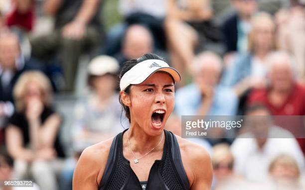 Qiang Wang of China celebrates during the lades singles third round match against Yulia Putintseva of Kazhakstan during day six of the 2018 French...