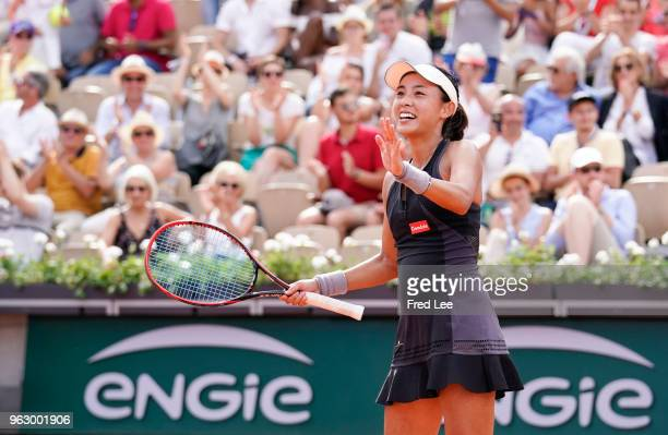 Qiang Wang of China celebrates winning her first round ladies singles match against Venus Williams of USA during day one of the French Open at Roland...