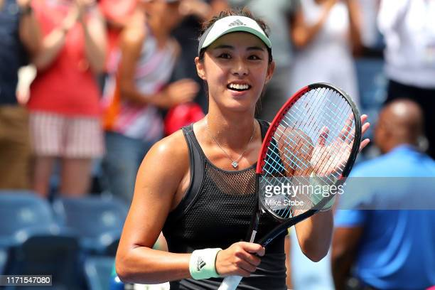 Qiang Wang of China celebrates winning her Women's Singles fourth round match against Ashleigh Barty of Australia on day seven of the 2019 US Open at...