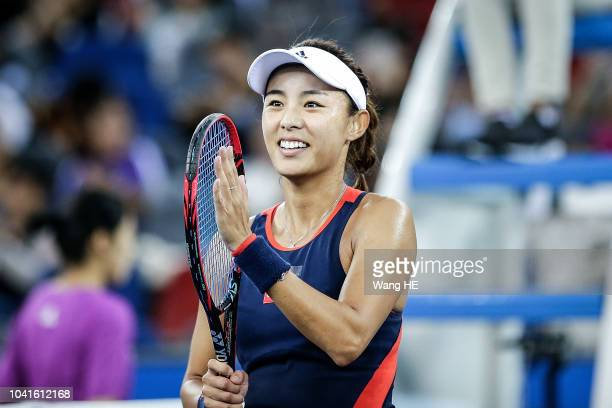 Qiang Wang of China celebration win the game against Monica Puig of Puerto Rico during 2018 Wuhan Open at Optics Valley International Tennis Center...