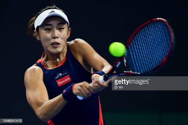 Qiang Wang of China hits a return against Aryna Sabalenka of Belarus during her Women's Singles Quarterfinals match in the 2018 China Open at the...