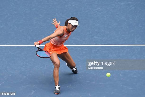 Qiang Wang of China plays a backhand against Anastasia Pavlyuchenkova of Russia during day three of the Toray Pan Pacific Open Tennis At Ariake...