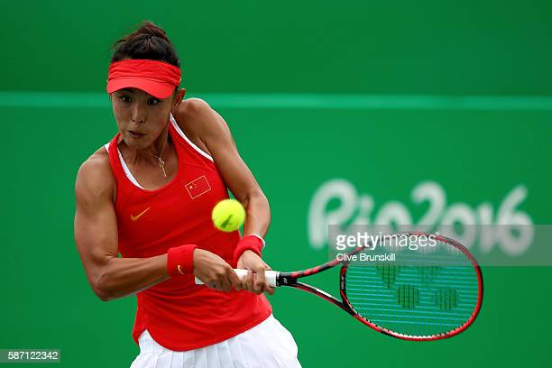 Qiang Wang of China plays a backhand against Swetlana Kuznetsova of Russia in their first round match on Day 2 of the Rio 2016 Olympic Games at the...
