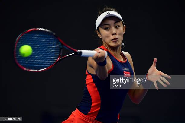 Qiang Wang of China plays a backhand Karolina Pliskova of the Czech Republic during their Women's Singles 3rd Round match of the 2018 China Open at...