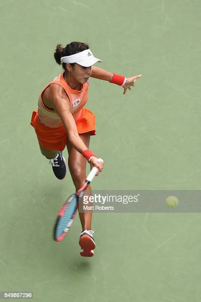 Qiang Wang of China plays a forehand against Anastasia Pavlyuchenkova of Russia during day three of the Toray Pan Pacific Open Tennis At Ariake...