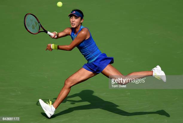 Qiang Wang of China plays a forehand during her match against Kristina Mladenovic of France on day four of the WTA Dubai Duty Free Tennis...