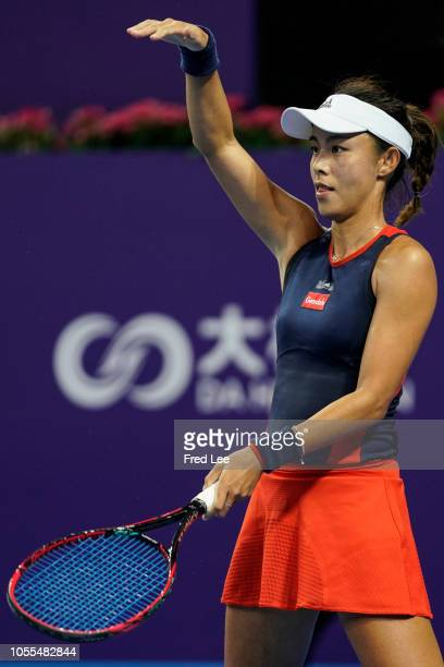 Qiang Wang of China reacts against Daria Kasatkina of Russia during a match on day 1 of 2018 WTA Elite Trophy Zhuhai at Hengqin Tennis Center on...