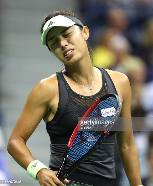 Qiang Wang of China reacts to a lost point during her Women's Singles quarterfinal match against Serena Williams of the United States on day nine of...