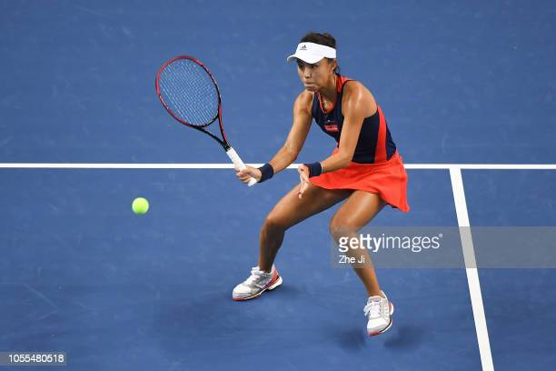 Qiang Wang of China return a shot against Daria Kasatkina of Russia during the women's singles group stage match on day 1 of the 2018 WTA Elite...