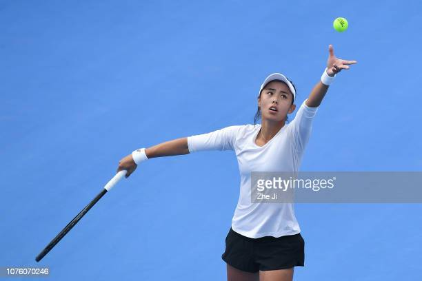Qiang Wang of China returns a shot against Alison Riske of The United States during the women's singles 1st Round match on main draw day 2 of the...