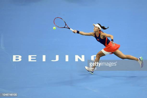 Qiang Wang of China returns a shot against Caroline Wozniacki of Denmark during the Women's Single Semifinal Match on day 8 of 2018 China Open at the...