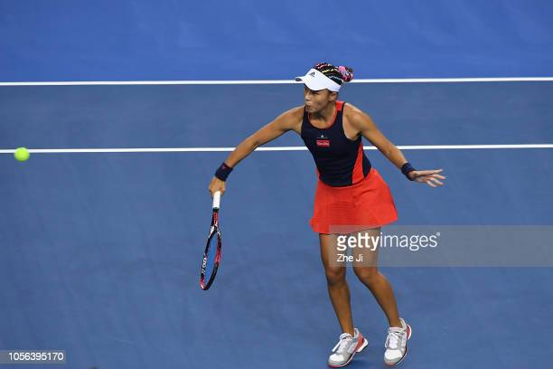 Qiang Wang of China returns a shot against Madison Keys of the United States during their women's singles match on day 4 of the 2018 WTA Elite Trophy...
