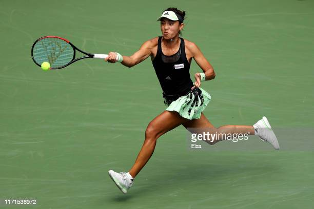 Qiang Wang of China returns a shot during her Women's Singles fourth round match against Ashleigh Barty of Australia on day seven of the 2019 US Open...