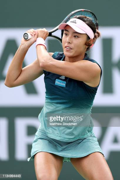 Qiang Wang of China returns a shot to Elise Mertens of Belgium during the BNP Paribas Open at the Indian Wells Tennis Garden on March 10 2019 in...