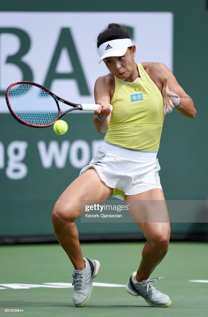Qiang Wang of China returns against Simona Halep of Romania during Day 9 of BNP Paribas Open on March 13, 2018 in Indian Wells, California.